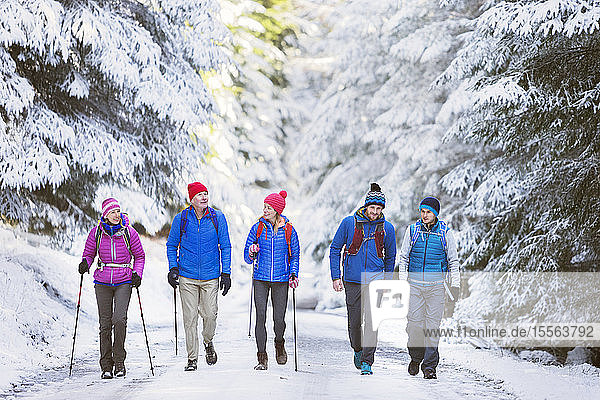 Family hiking in snowy woods