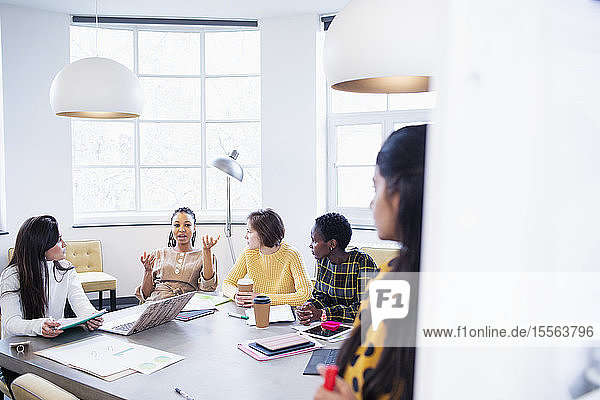 Businesswomen talking in conference room meeting