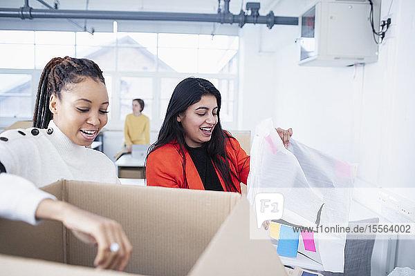 Businesswomen unpacking new office
