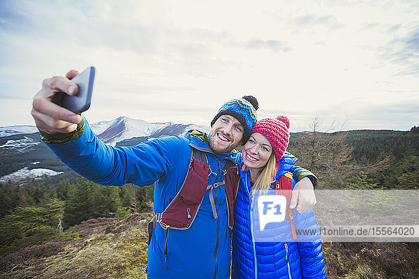 Couple taking selfie on mountaintop