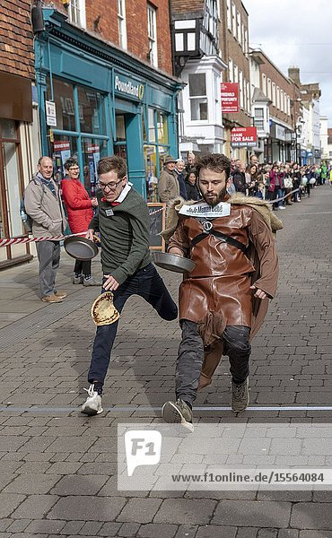 Salisbury  Wiltshire UK. 5th March 2019. Competitors competing in the annual pancake race on High Street  Salisbury. The event is organised by St Thomas's Church and the Trussell Trust.