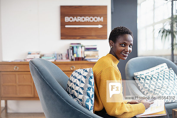 Portrait confident businesswoman working in office
