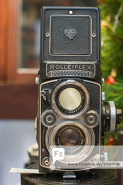 A Rolleiflex 3.5E Planar TLR camera with viewing hood open and magnifier raised.
