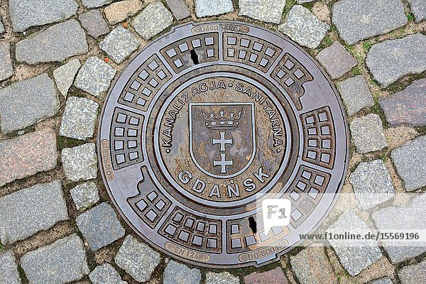 Gdansk  Pomeranian  Poland - June 19  2019: Man hole cover with the coat of arms of the Polish city Gdansk - Poland.