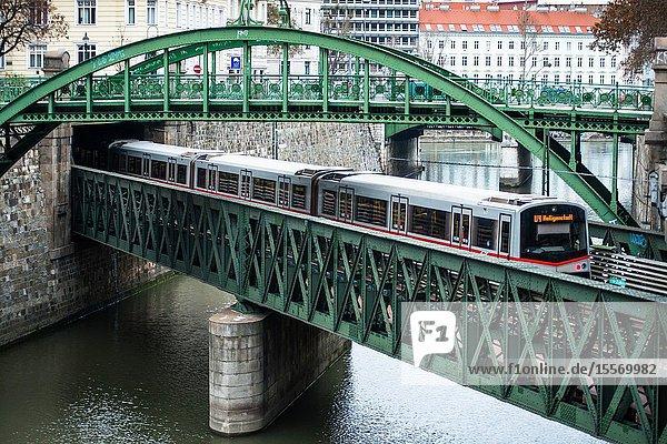 Zollamtssteg Arch Bridge with Zollamtsbrücke Truss Bridge and U-Bahn train  Vienna  Austria.