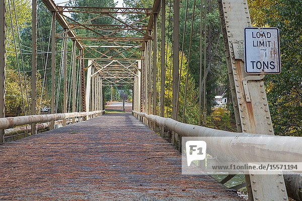 An old steel arch bridge is still used for pedestrians and smaller mechanized machines.