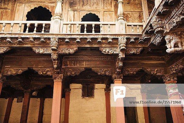 Structural wood work and heavily carved wooden pillars Palashikar Wada at Palashi  Ahmednagar District  Maharashtra  India.