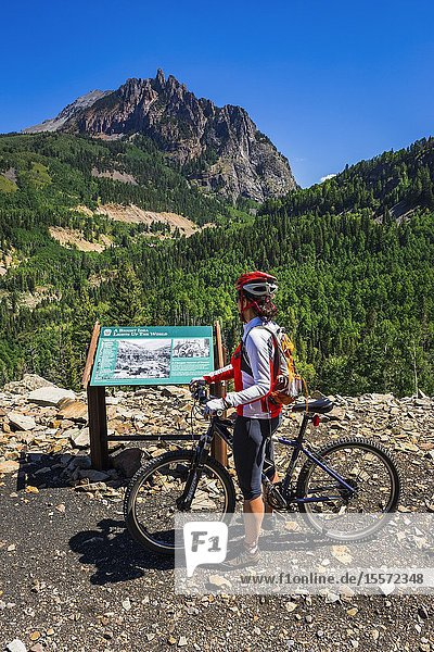 Mountain biker and interpretive sign on the Galloping Goose Trail  Uncompahgre National Forest  Colorado USA (MR).