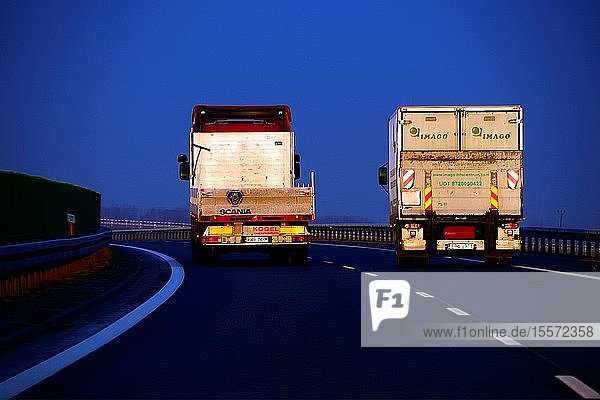 Trucks on highway in winter morning at sunrise. southern Poland  Europe