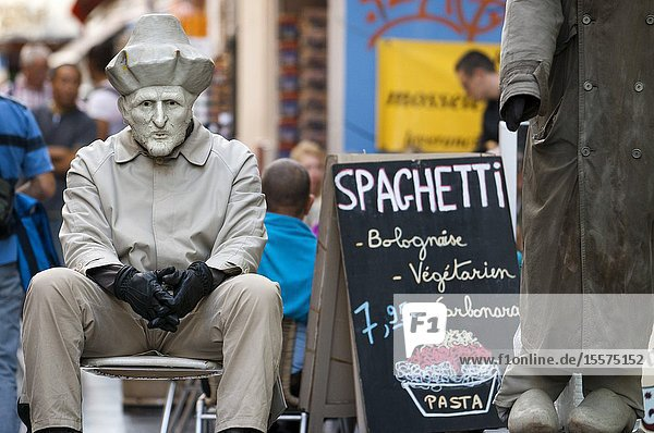 Advertising man of spaghetti pasta at Rue du Marche aux Fromages  Brussels  Belgium. Several restaurants at Rue du Marche aux Fromages  Brussels  Belgium. In the center of Brussels abound terraces and restaurants offering cuisine from different parts of the continent.