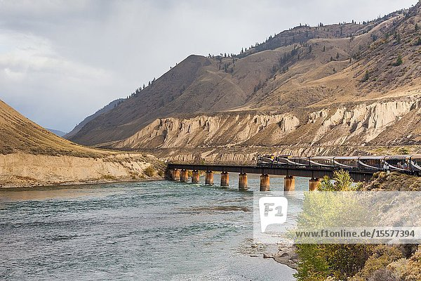 The Rocky Mountaineer tourist train crossing the Thompson River close to Ashford in British Columbia Canada.
