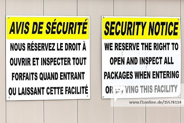 Corner Brook Newfoundland Canada. Security signs at port in French and English.