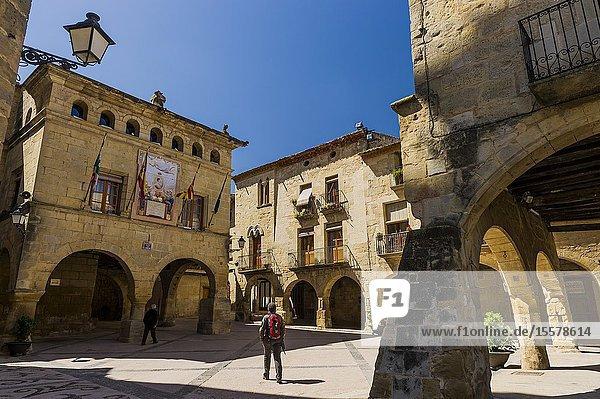 Tourist in Church Square in Horta de Sant Joan town (Tarragona province  Catalonia  Spain)