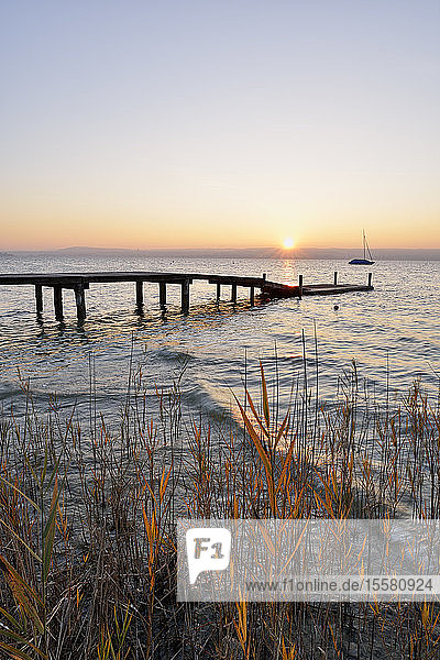 Pier over lake Ammersee against clear sky during sunset  Germany