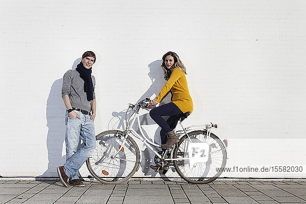 Germany  Bavaria  Munich  Young couple with bike  smiling  portrait