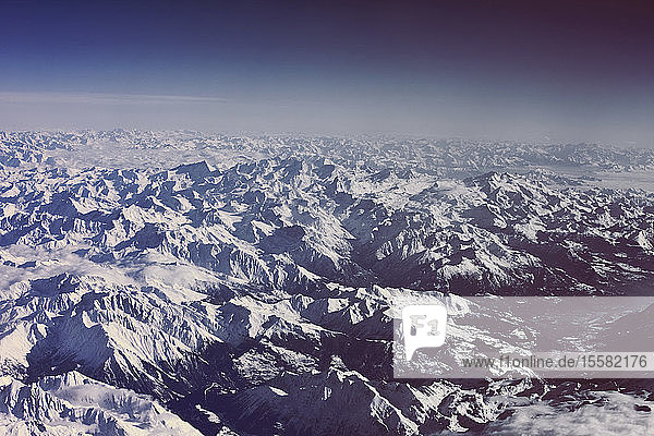 View of snowy Alps as seen from an airplane