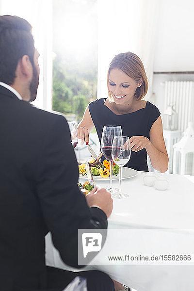 Elegant couple having dinner in restaurant