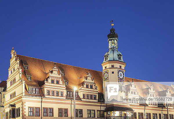 Low angle view of Town Hall Tower against clear blue sky in Leipzig at night  Germany