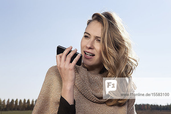 Germany  Bavaria  Munich  Young woman on cell phone