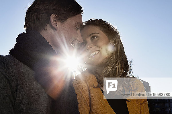 Germany  Bavaria  Munich  Young couple face to face  smiling