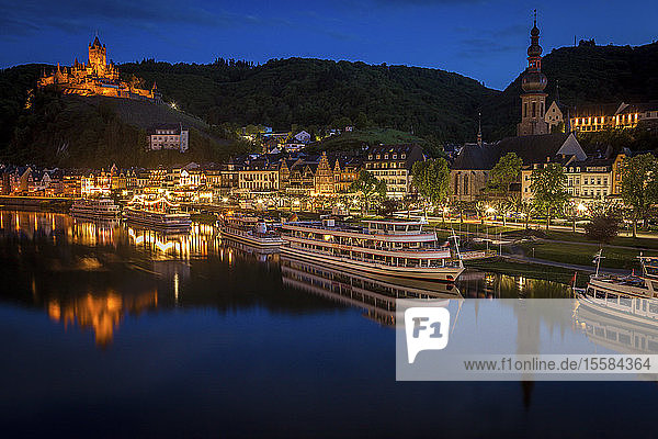 Town and Cochem Imperial Castle by river at sunset in Cochem  Germany