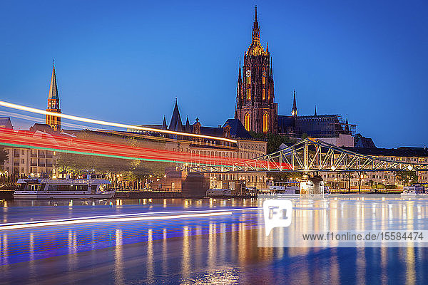 Light trails on river at sunset in Frankfurt  Germany
