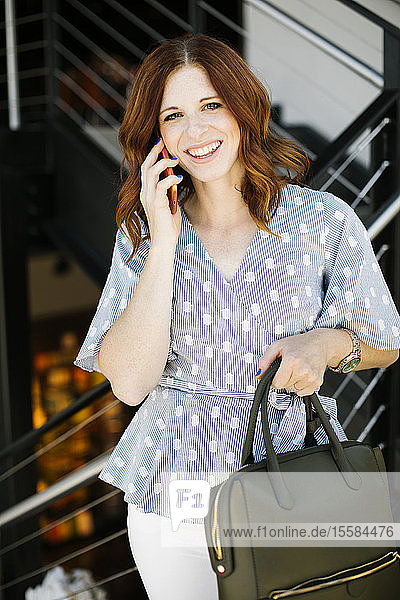 Smiling mid adult woman on phone call