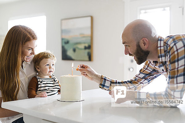 Parents and son with birthday cake