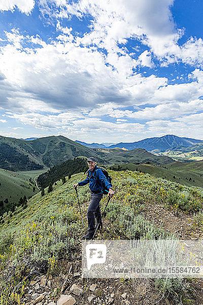 Smiling senior man hiking in Sun Valley  Idaho  USA
