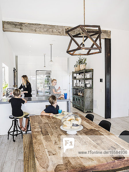 Mother and children in kitchen and dining room
