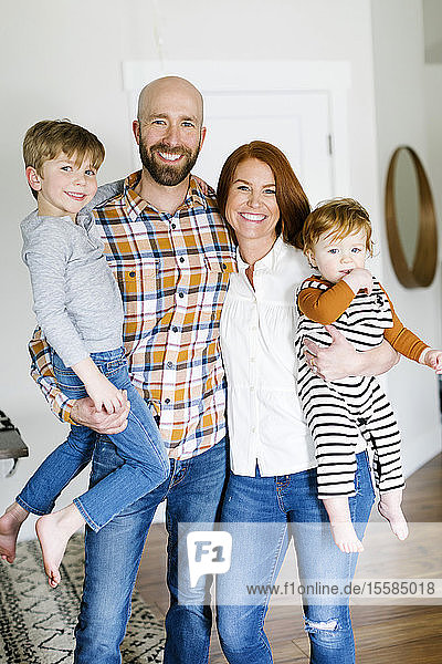 Smiling family in home