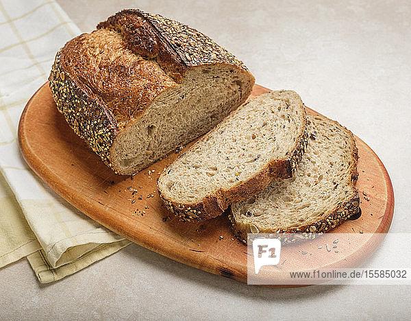 Sliced loaf of bread on cutting board