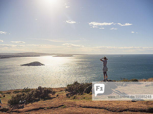 Woman looking at view of Victor Harbor  South Australia  Australia
