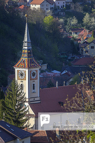 Church with clock tower in Brasov  Romania