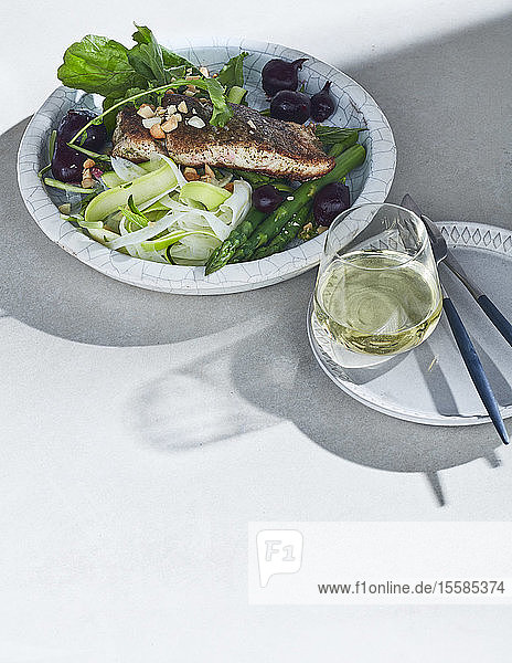 High key still life with barramundi lemon myrtle and native spices on white table