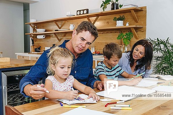 Parents helping children with homework at home