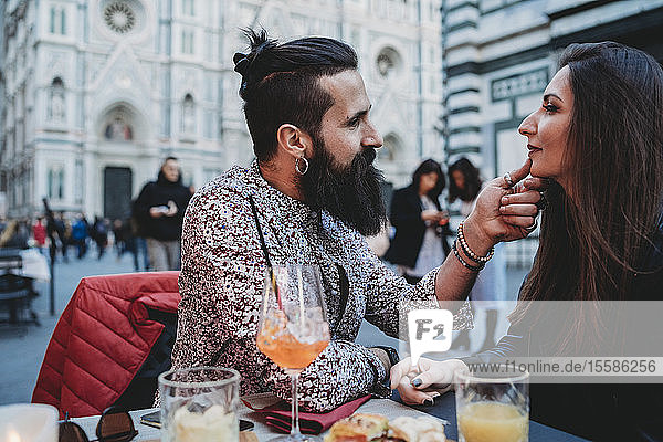 Man tenderly touching chin of woman in cafe  Santa Maria del Fiore  Firenze  Toscana  Italy