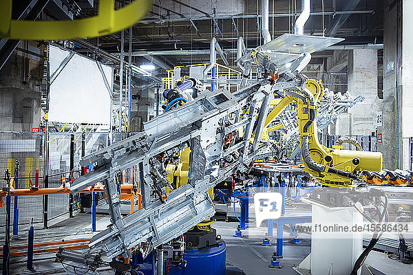 Robots spot welding car parts in car factory