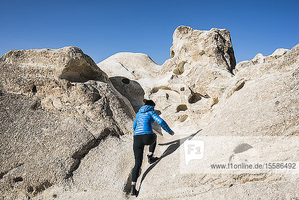 Woman exploring rock formations  Göreme  Cappadocia  Nevsehir  Turkey