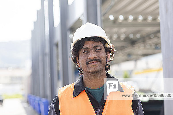 Male engineer on construction site  head and shoulder portrait