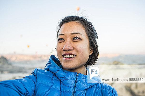 Woman looking into distance smiling  Göreme  Cappadocia  Nevsehir  Turkey