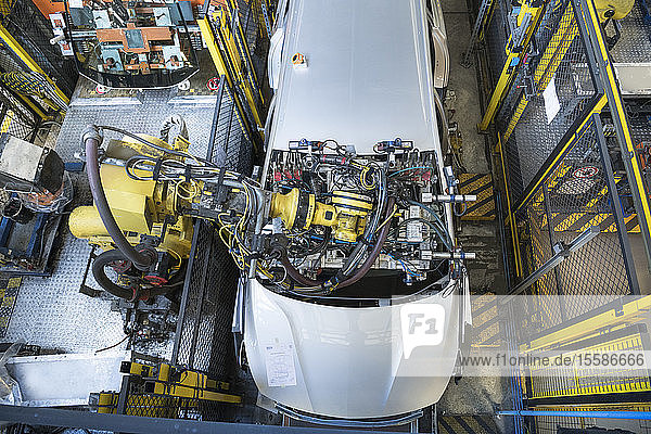 Robot inserting car windscreen in car factory