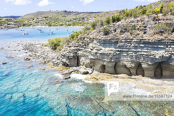 White limestone cliffs Pillar of Hercules washed by Caribbean Sea  aerial view by drone  English Harbour  Antigua  Leeward Islands  West Indies  Caribbean