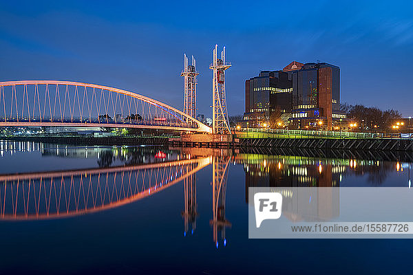 The Footbridge reflected in the River Irwell at night  Salford Quays  Manchester  England  United Kingdom