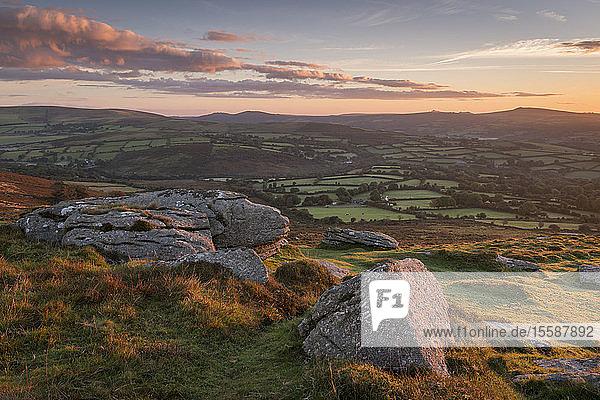 Sunrise over rolling countryside from Corndon Tor  Dartmoor  Devon  England  United Kingdom
