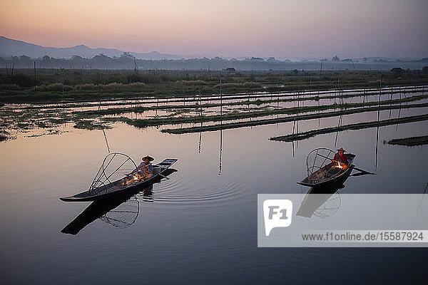 Two Intha leg rowing fisherman at Inle Lake gardens  Inle Lake  Shan State  Myanmar (Burma)