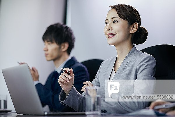 Japanese businesspeople having a meeting