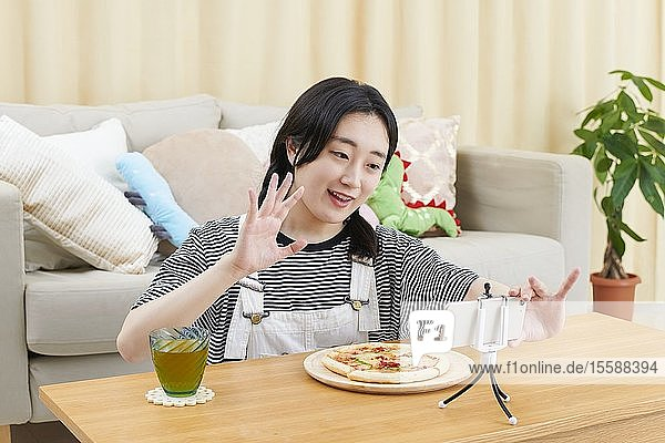 Young Japanese youtuber streaming at home