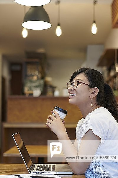 Young Japanese woman at a cafe