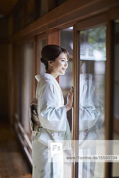 Young Japanese woman wearing traditional kimono